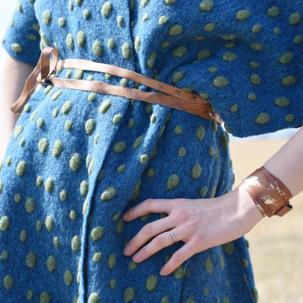 blue poncho, tan belt